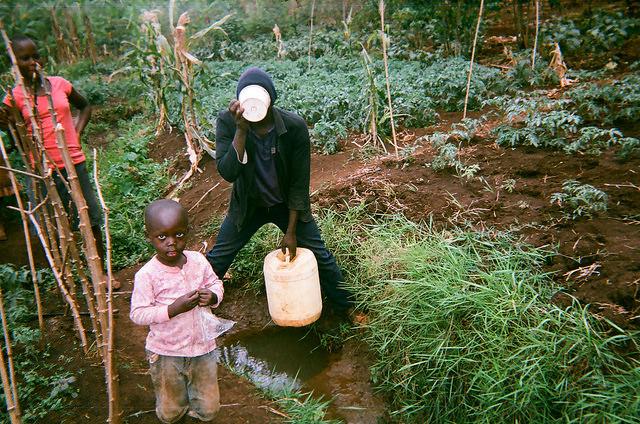 coffee farmers in Uganda drinking