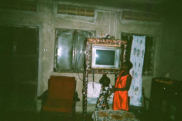 coffee farmers in Uganda home with TV