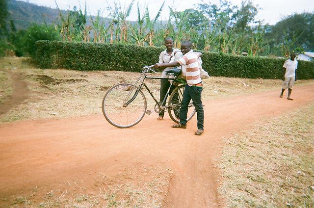 coffee farmers in Uganda kids with bike